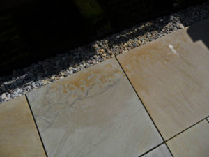 Yellow stianing to patio slabs