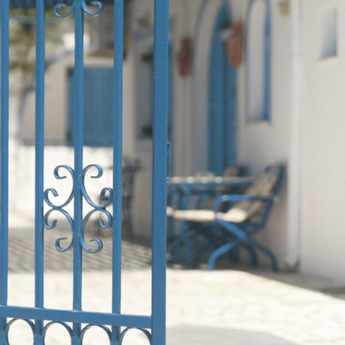 Blue Owatrol Deco applied to a metal gate