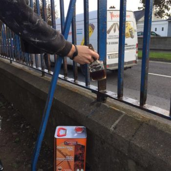 Owtatrol oil as a rust inhibitor being used on a metal fence