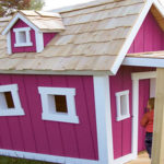 Whimsical pink childrens playhouse