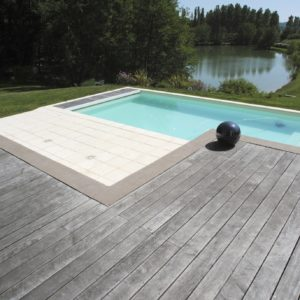 Before application of Tropitech on poolside deck