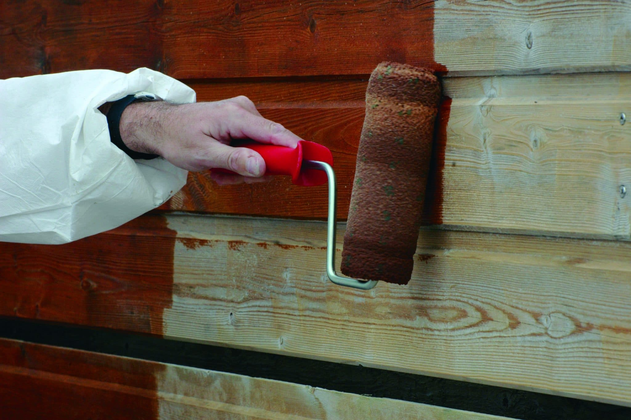 Textrol being applied to a shed