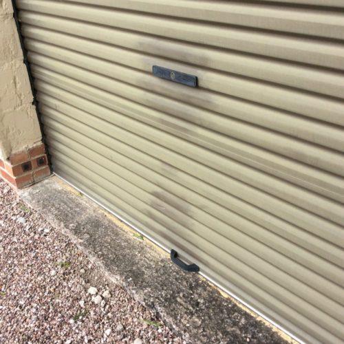 Garage doors before polytrol