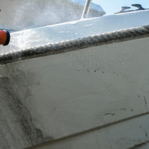 Rinsing off Owaclean from a boat gelcoat