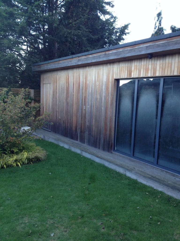 Cedar clad office and gym before Owatrol products