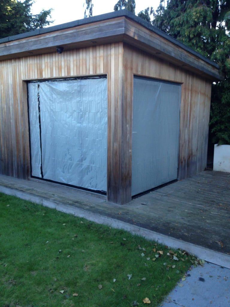 Cedar clad office and gym after Net-Trol application