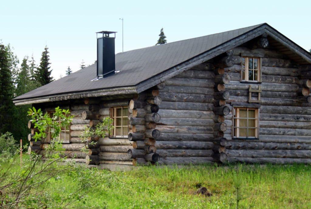 Log cabin in a field