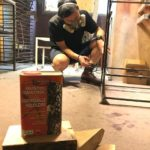 Owatrol Oil being applied to metal legs on a piece of SPRUE furniture