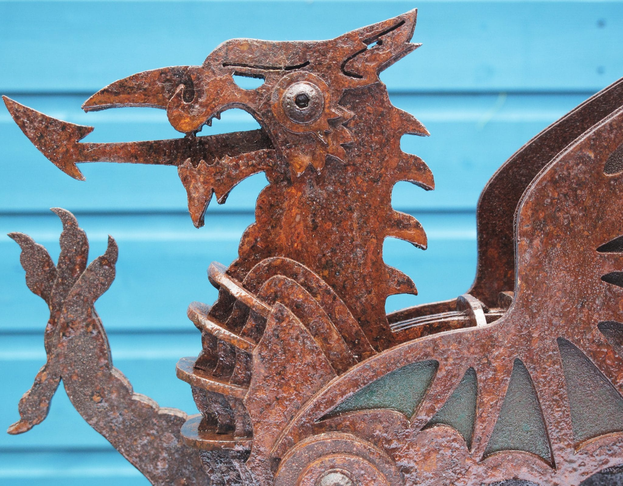 Close up of Black Sheep Steel Dragon Sculpture finished with Owatrol Oil