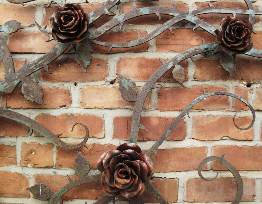 Close up of metal rose artwork protected with Owatrol Oil