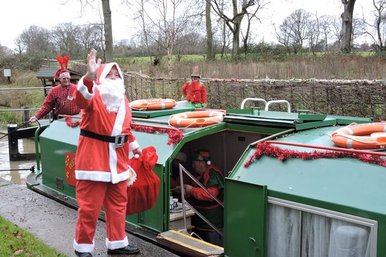 Santa next to narrowboat