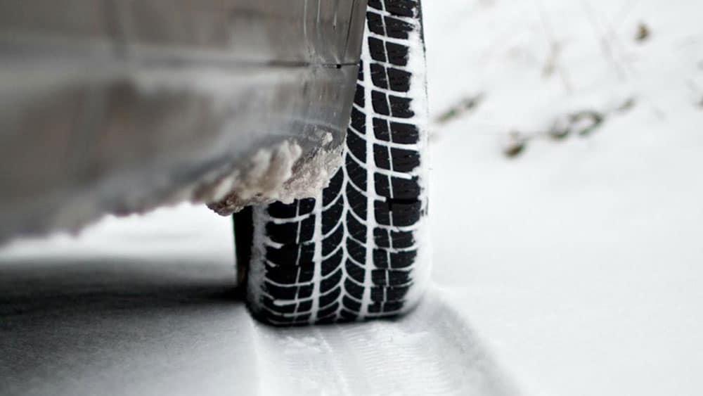 Tire tread full of snow