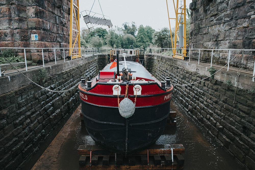 Barge in dry dock awaiting hull blacking