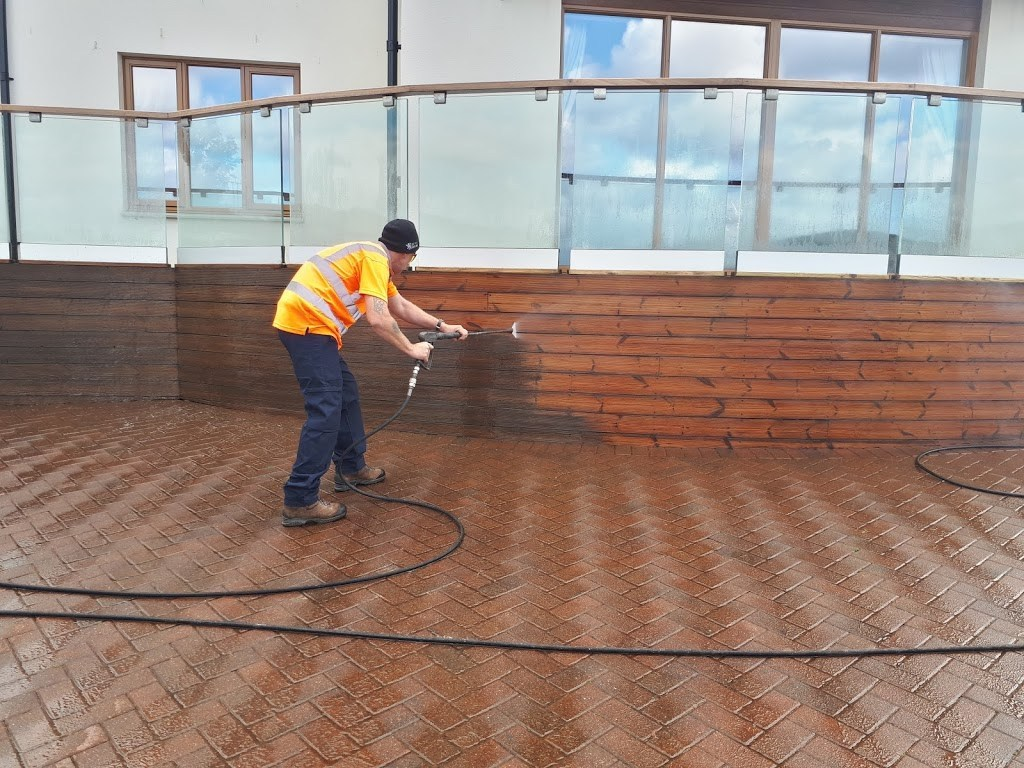 pressure washing the previous coating off - image credit to SoftWash Scotland