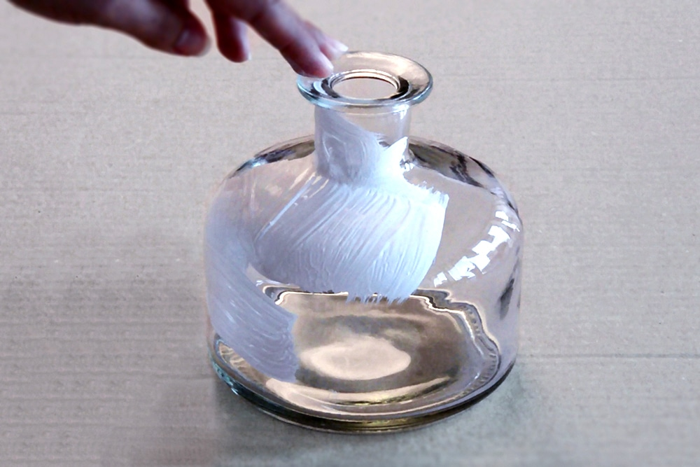 Absolute primer being applied to a glass vase