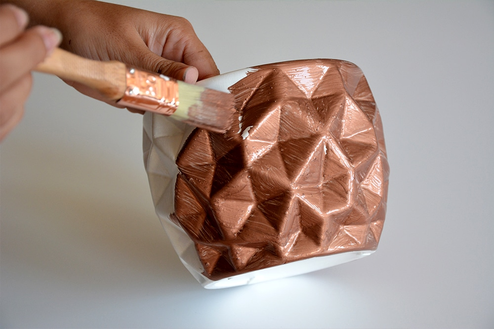 Reactiv leaf copper being applied to an ornament