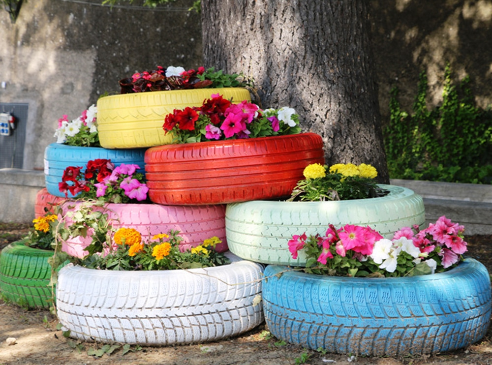 Raised garden beds made from old car tyres