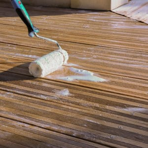 Application of Renoclear to a deck with a roller