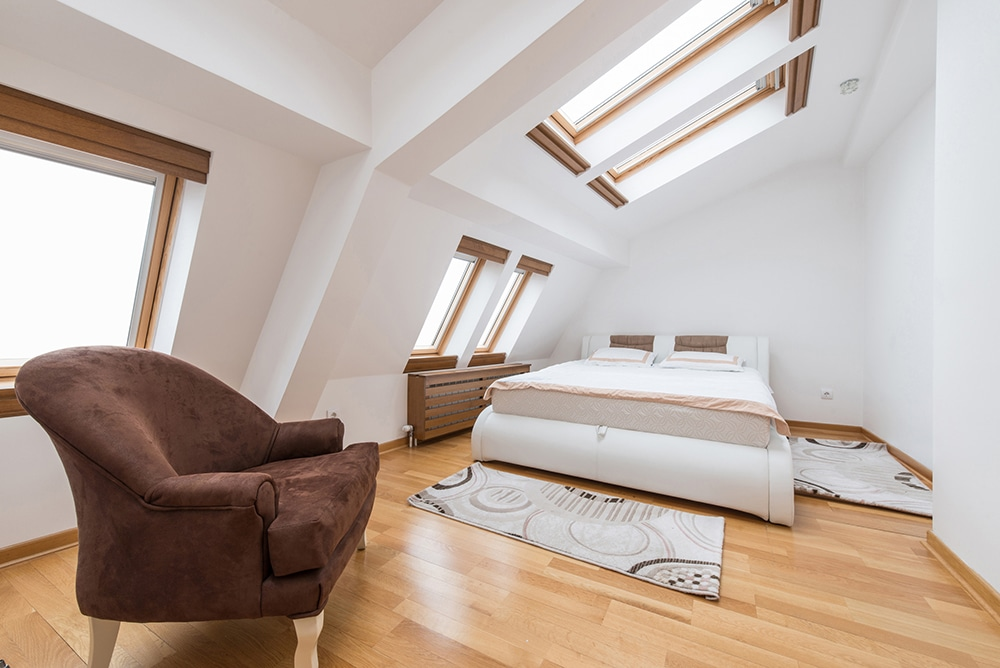 Loft conversion with bed and sitting area
