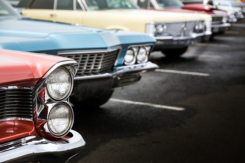 Classic cars lined up in a row