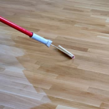 Flooring being finished with wood oil