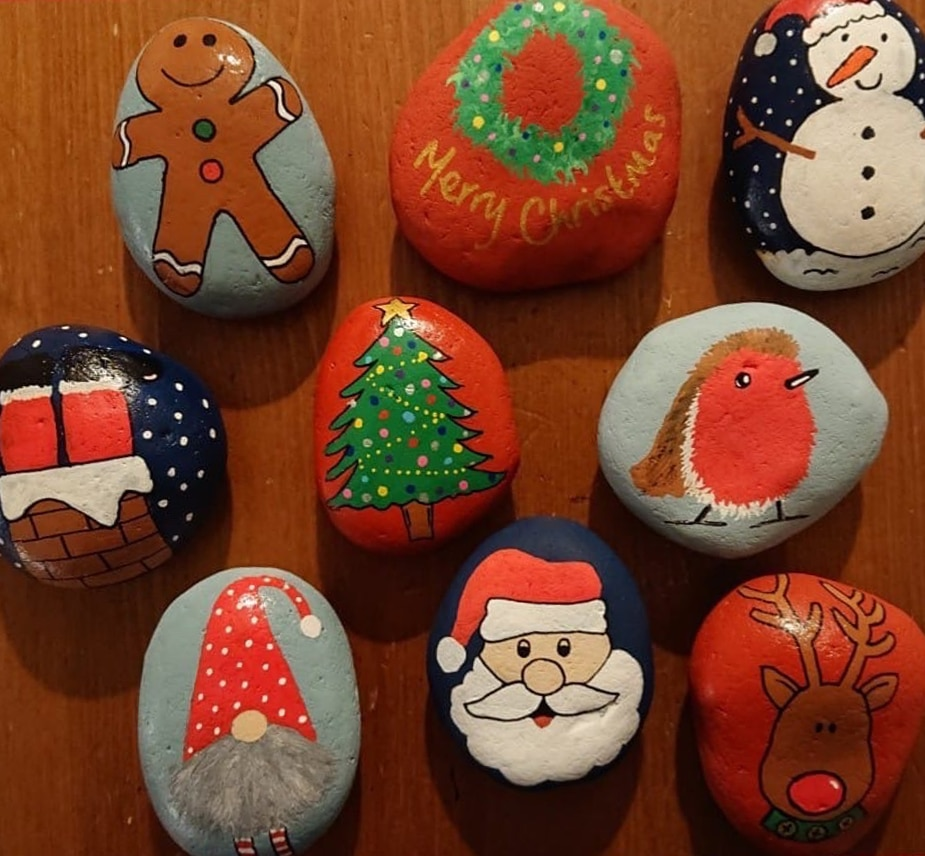 Rocks painted with a Christmas theme