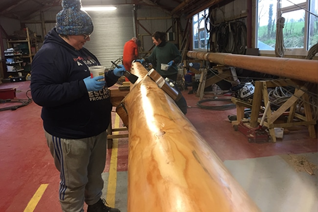Coat 2 of oil being applied by the volunteers to Tectona's Mizzen Mast by volunteers