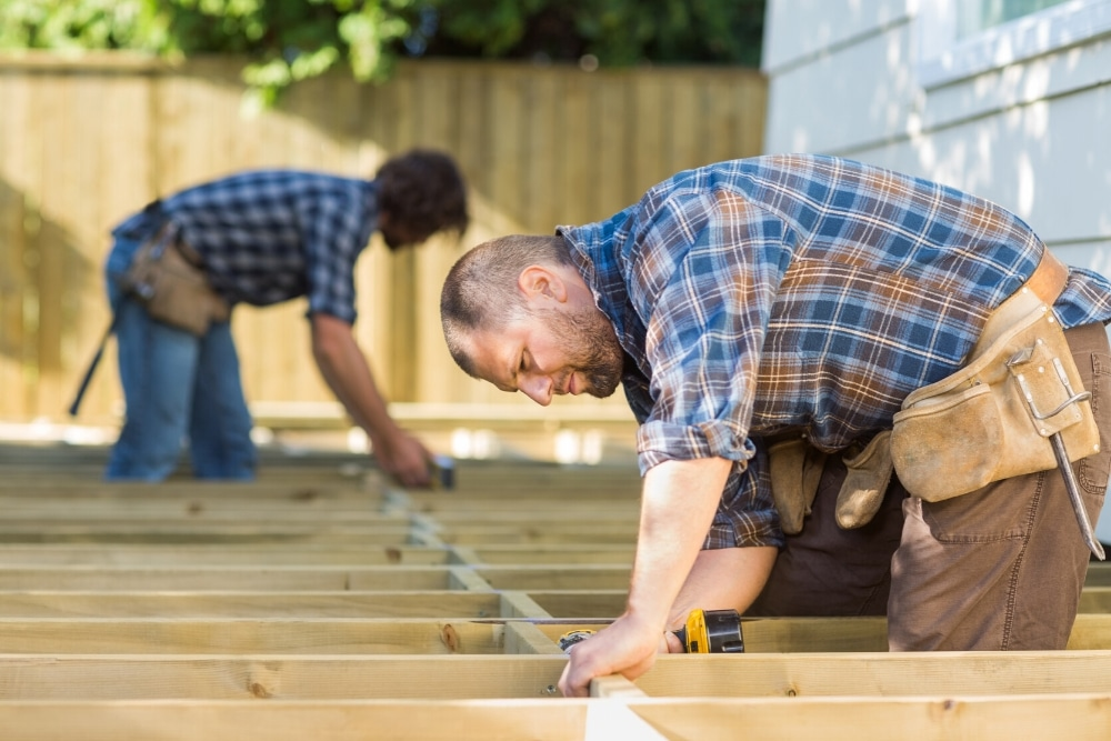 men building a garden deck