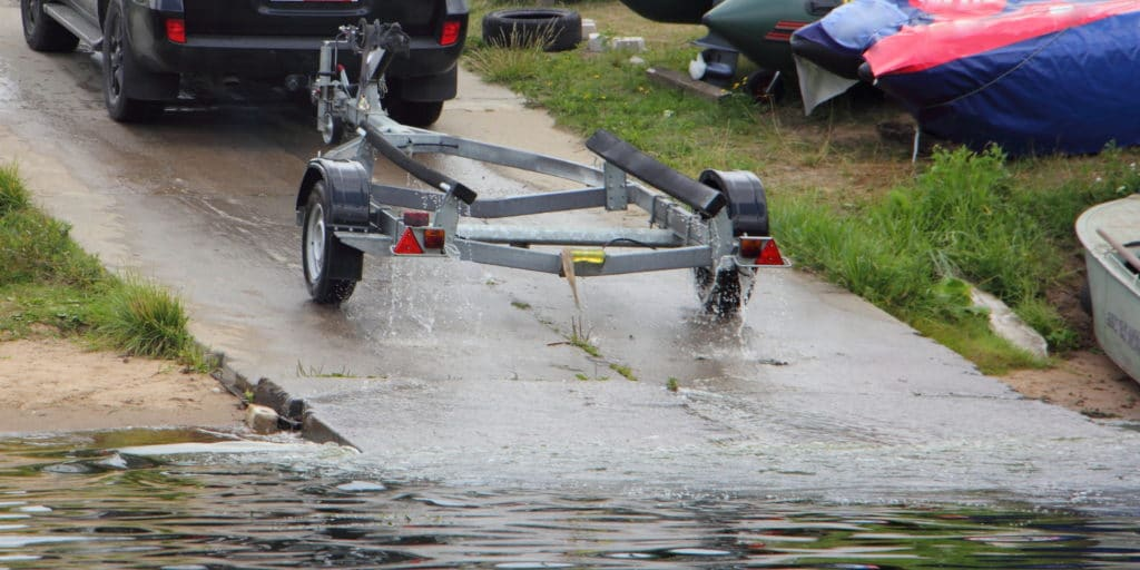 Car pulling a boat trailer after launching a boat