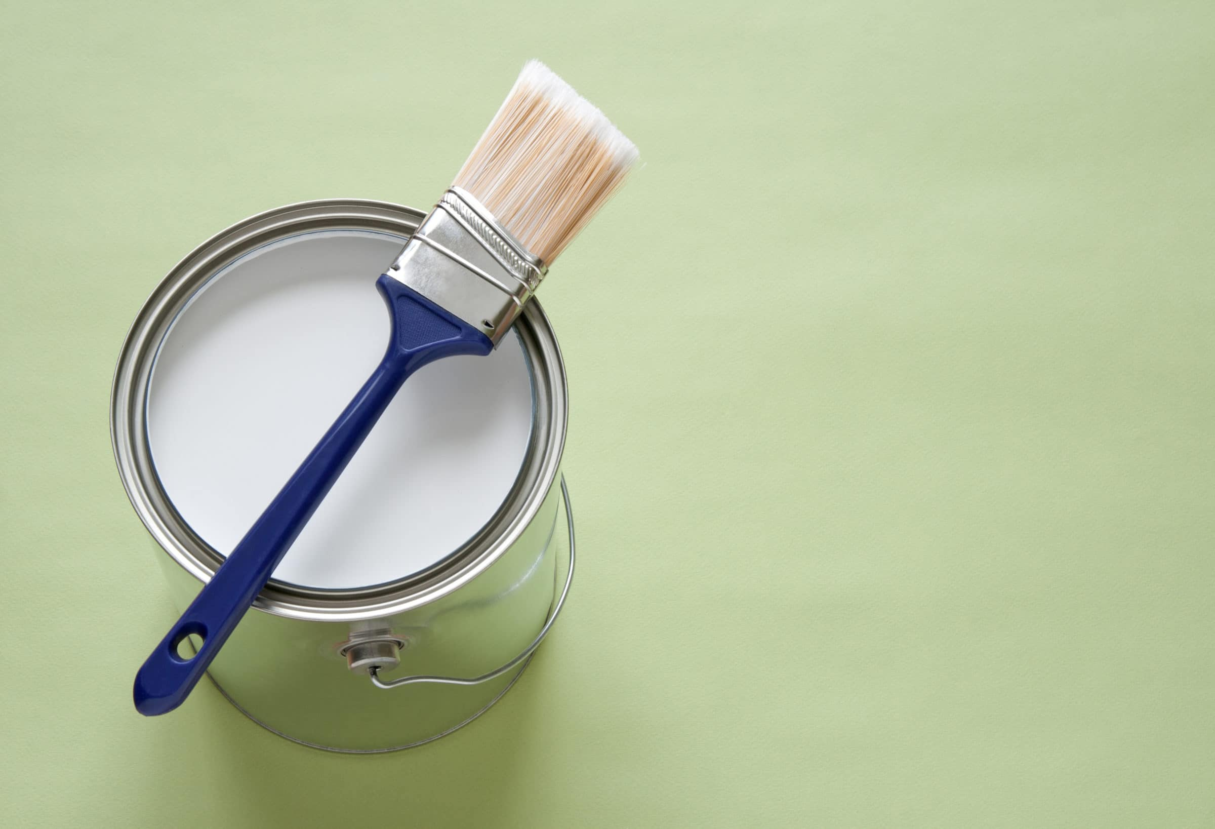 Angled paint brush and tin of paint